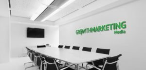 Conference room with growth marketing signage
